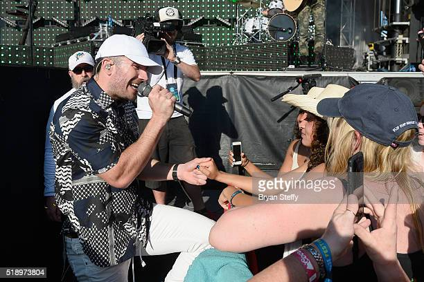 Singer Sam Hunt performs in the crowd during the 4th ACM Party For A Cause Festival at the Las Vegas Festival Grounds on April 3 2016 in Las Vegas...