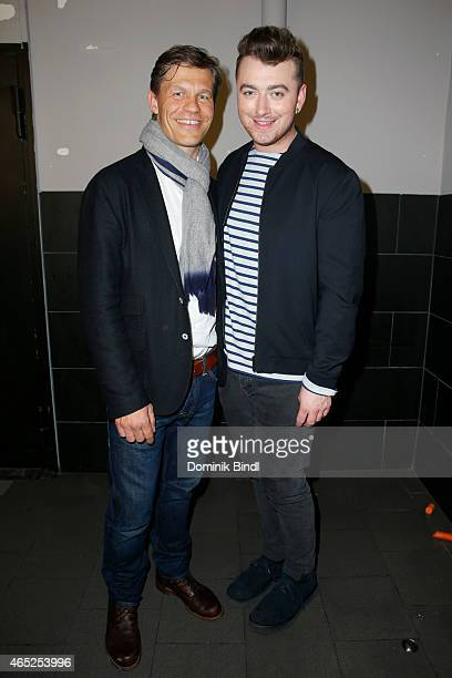 Singer Sam Smith and the CEO of Universal Music Deutschland Frank Briegmann pose for a picture after a concert at Zenith on March 4 2015 in Munich...
