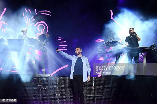 Singer Sam Smith performs with Guy Lawrence and Howard Lawrence onstage during on day 2 of the 2016 Coachella Valley Music Arts Festival Weekend 1 at...