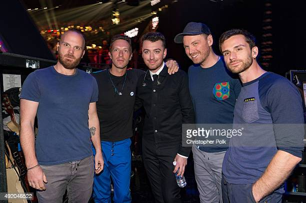 Singer Sam Smith poses with musicians Will Champion Chris Martin Jonny Buckland and Guy Berryman of Coldplay backstage at the 2015 iHeartRadio Music...