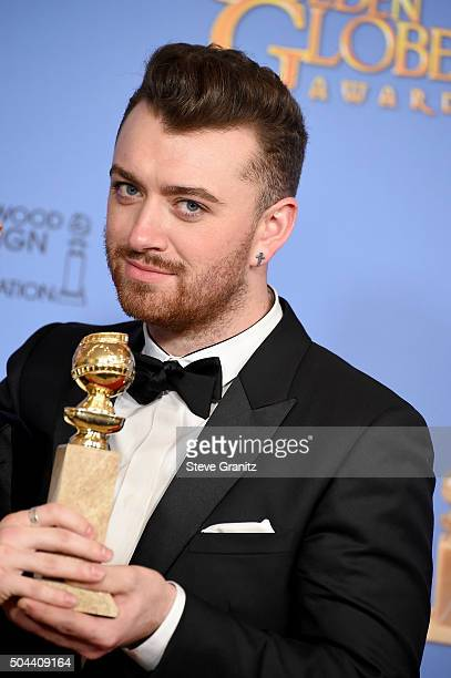 Singer Sam Smith winner of the award for Best Original Song Motion Picture for 'Writing's on the Wall' from 'Spectre' poses in the press room during...