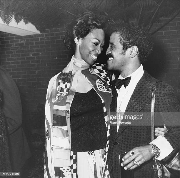 Singer Sammy Davis Jr and his wife Altovise looking into each others eyes as they attend 'A Tribute to Vincente Minnelli at the USC Town and Gown...