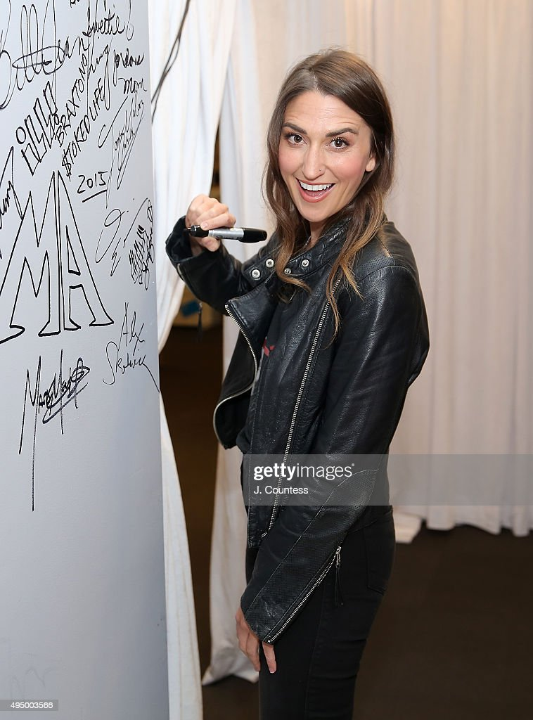 Singer Sara Bareilles signs the wall following the AOL BUILD Presents: 'Sounds Like Me: My Life (So Far) In Song' at AOL Studios In New York on October 30, 2015 in New York City.