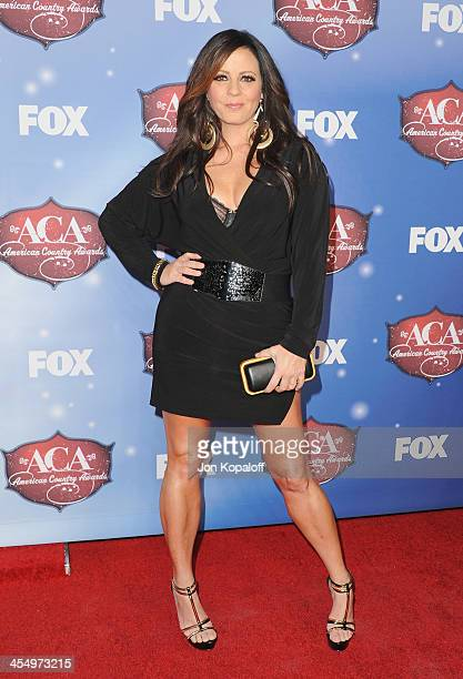 Singer Sara Evans arrives at the American Country Awards 2013 at the Mandalay Bay Events Center on December 10, 2013 in Las Vegas, Nevada.