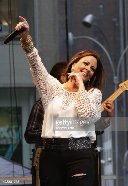 Singer Sara Evans performs during 'FOX Friends' All American Concert Series outside of FOX Studios on May 23 2014 in New York City