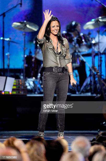 Singer Sara Evans performs onstage during ACM Presents Girls' Night Out Superstar Women of Country concert held at the MGM Grand Garden Arena on...