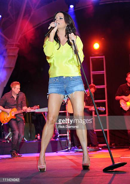 Singer Sara Evans performs onstage during the Academy of Country Music concerts on Fremont at the Fremont Street Experience on April 1, 2011 in Las...