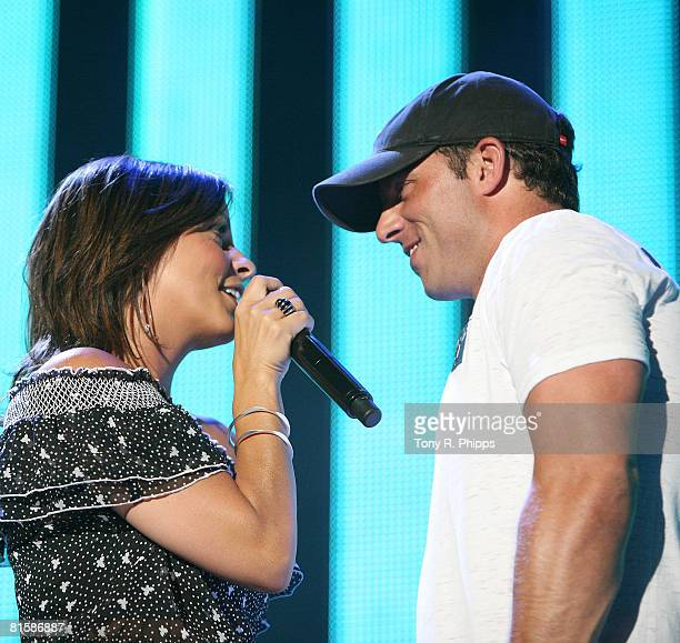 Singer Sara Evans sings to her fiancee Jay Barker while performing at the VAULT Concert Stages during the 2008 CMA Music Festival on June 8 2008 at...