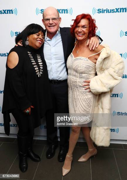 Singer Sarah Dash President/ Chief Content Officer of SiriusXM Radio Scott Greenstein and Carmen D'Alessio pose for photos during a SiriusXM Town...