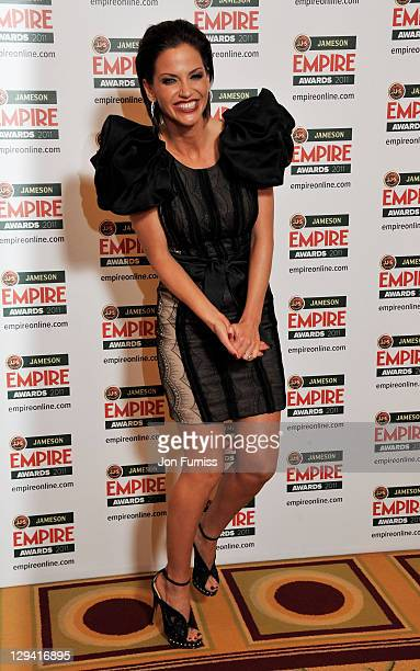 Singer Sarah Harding poses in the press room at the Jameson Empire Awards at The Grosvenor House Hotel on March 27 2011 in London England