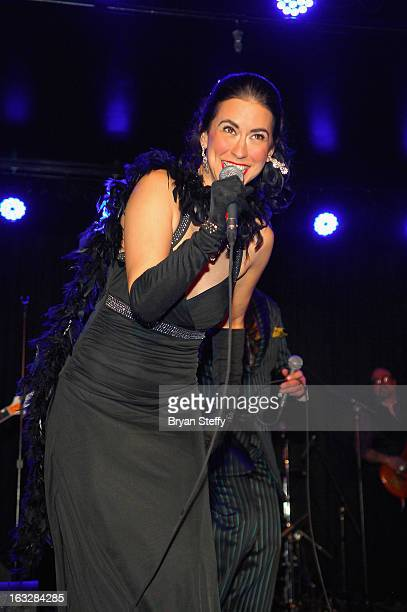 Singer Sarah Spiegel of Louis Prima Jr and the Witnesses performs during the grand opening of the Fremont Country Club on March 6 2013 in Las Vegas...