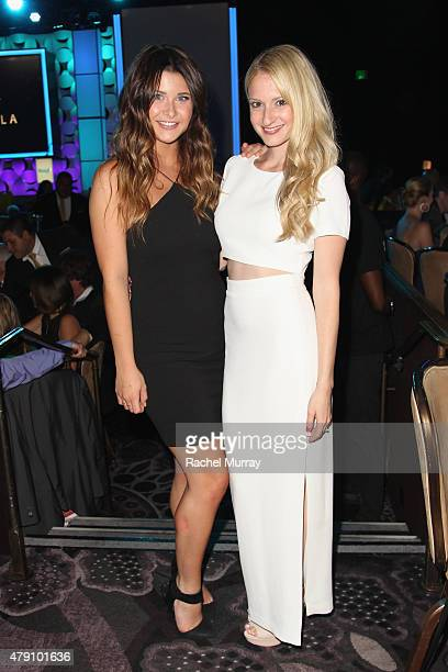 Singer Savannah Outen and actress Dove Cameron attend the 6th Annual Thirst Gala at The Beverly Hilton Hotel on June 30 2015 in Beverly Hills...