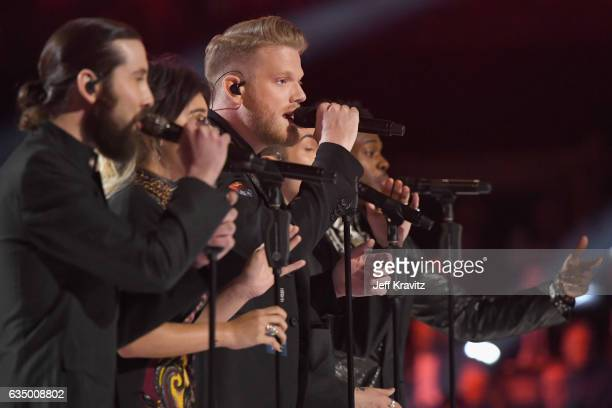 Singer Scott Hoying and fellow members of Pentatonix perform a tribute to the Bee Gees onstage during The 59th GRAMMY Awards at STAPLES Center on...
