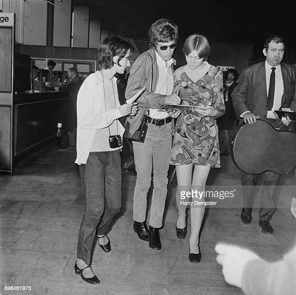 Singer Scott Walker of The Walker Brothers signs autographs for fans at London Airport whilst en route to Moscow 26th September 1967