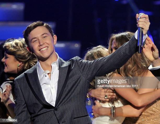 Singer Scotty McCreery is announced the American Idol for 2011 onstage performs onstage during Fox's American Idol 2011 finale results show held at...
