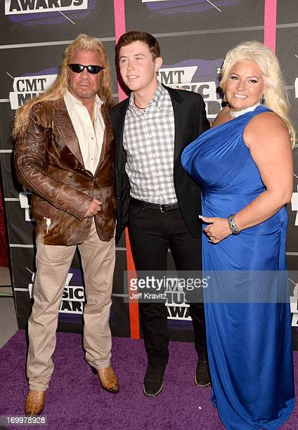 "Singer Scotty McCreery joins TV personalities Duane ""Dog"" Lee Chapman and Beth Chapman at the 2013 CMT Music Awards at the Bridgestone Arena on June..."