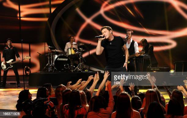 Singer Scotty McCreery performs onstage at FOX's American Idol Season 12 Top 6 To 5 Live Elimination Show on April 11 2013 in Hollywood California