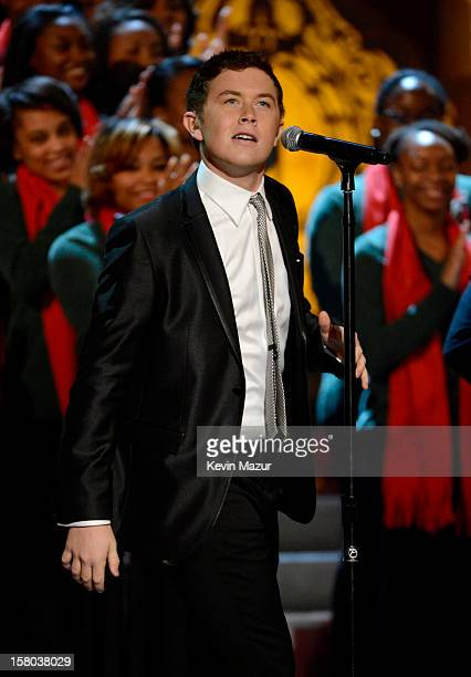 Singer Scotty McCreery performs onstage during TNT Christmas in Washington 2012 at National Building Museum on December 9 2012 in Washington DC...