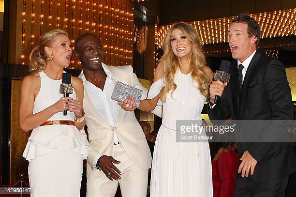 Singer Seal and Delta Goodrem are interviewed by Sonia Kruger and Jules Lund as they arrive at the 2012 Logie Awards at the Crown Palladium on April...