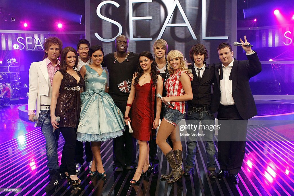 Singer Seal and the German superstar candidates look on during a photo call after the rehearsel for the singer qualifying contest DSDS 'Deutschland sucht den Superstar' mottoshow on March 14, 2009 in Cologne, Germany.
