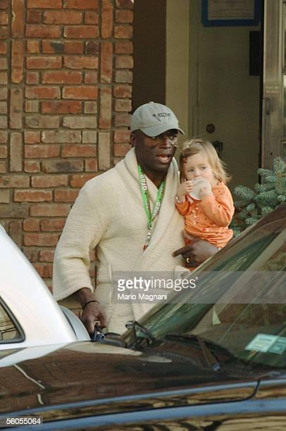 Singer Seal husband of supermodel Heidi Klum exits their residence in his bathrobe with her child Leni on November 1 2005 in New York City