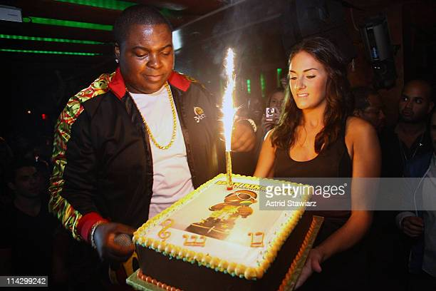 Singer Sean Kingston holds a cake celebrating his album release party at Tenjune on September 22, 2009 in New York City.