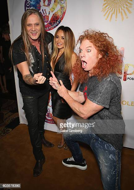 Singer Sebastian Bach and his wife model Suzanne Le Bach are photobombed by comedian Carrot Top during Criss Angel's HELP charity event at the Luxor...