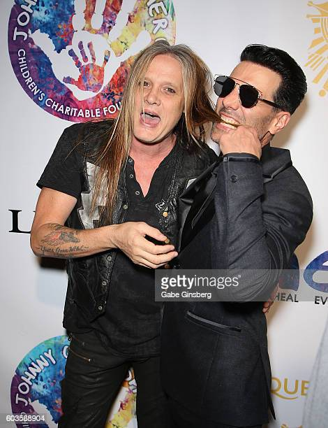 Singer Sebastian Bach jokes around with illusionist Criss Angel during Criss Angel's HELP charity event at the Luxor Hotel and Casino benefiting...