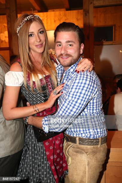 Singer Sebastian Buergin Baschi and his girlfriend Alana Netzer daughter of Guenter and Elvira Netzer during the opening of the Oktoberfest 2017 at...