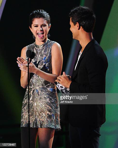Singer Selena Gomez and actor Taylor Lautner speak onstage during the 2011 MTV Video Music Awards at Nokia Theatre LA Live on August 28 2011 in Los...