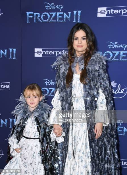 US singer Selena Gomez and her halfsister Gracie Teefay arrive for Disney's World Premiere of Frozen 2 at the Dolby theatre in Hollywood on November...