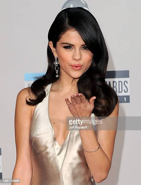 Singer Selena Gomez arrives at the 2011 American Music Awards held at Nokia Theatre LA Live on November 20 2011 in Los Angeles California