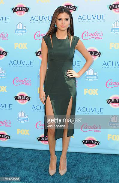 Singer Selena Gomez arrives at the 2013 Teen Choice Awards at Gibson Amphitheatre on August 11, 2013 in Universal City, California.