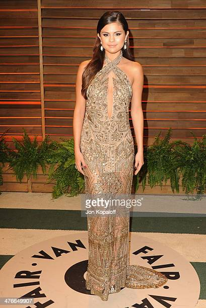 Singer Selena Gomez arrives at the 2014 Vanity Fair Oscar Party Hosted By Graydon Carter on March 3 2014 in West Hollywood California