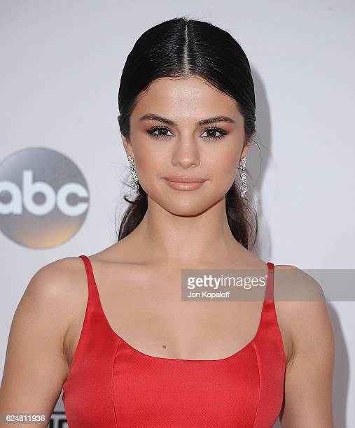 Singer Selena Gomez arrives at the 2016 American Music Awards at Microsoft Theater on November 20 2016 in Los Angeles California