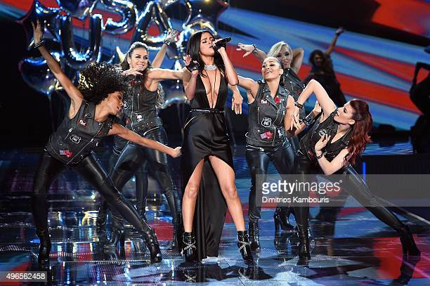 Singer Selena Gomez performs on the runway during the 2015 Victoria's Secret Fashion Show at Lexington Avenue Armory on November 10 2015 in New York...