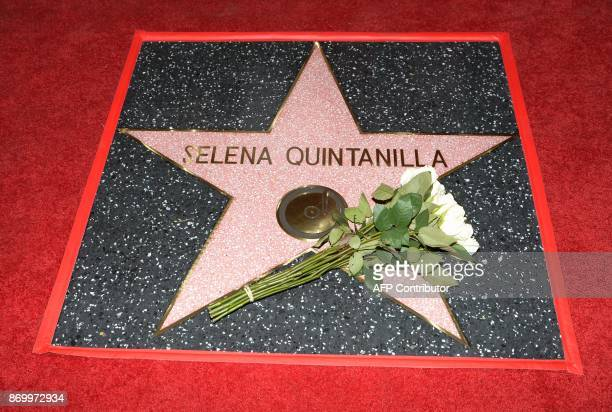 Singer Selena Quintanilla is honored posthumously with a Star on the Hollywood Walk of Fame on November 3 in Hollywood California / AFP PHOTO / TARA...