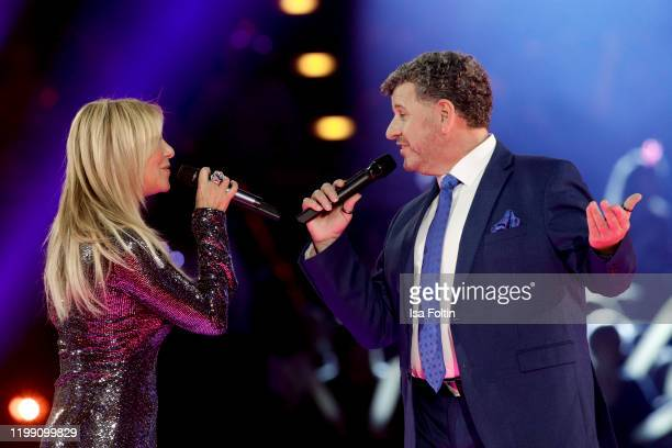 Singer Semino Rossi and Italian singer Rosanna Rocci perform during the television show Schlagerchampions Das grosse Fest der Besten at Velodrom on...