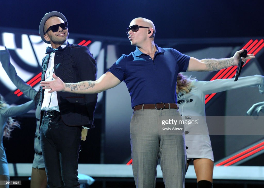 Singer Sensato (L) and rapper Pitbull perform onstage during rehearsals for the 13th annual Latin GRAMMY Awards at the Mandalay Bay Events Center on November 14, 2012 in Las Vegas, Nevada.