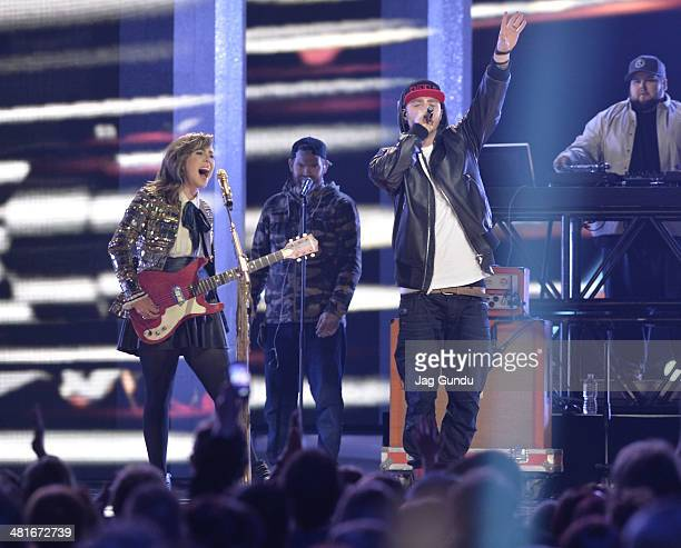 Singer Serena Ryder and Rapper Classified perform on stage at the 2014 Juno Awards Held at the MTS Centre on March 30 2014 in Winnipeg Canada