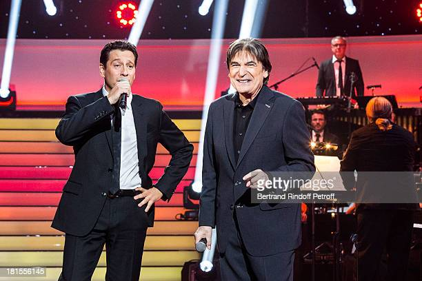 Singer Serge Lama and impersonator Laurent Gerra impersonating Serge Lama perform during the live broadcast on public channel France 2 of the program...