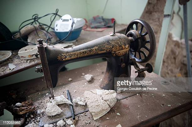 L'AQUILA ITALY APRIL 9 A Singer sewing machine stands abandoned inside a house collapsed in the historic village of Paganica two years on from the...