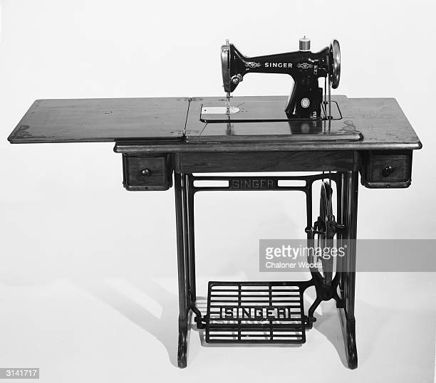 Singer sewing machine table with a foot pedal Graham Gillies