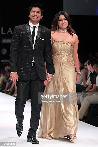Singer Shaan Mukherjee and Radhika Mukherjee walk the runway in an Troy Costa design at the Lakme Fashion Week Winter Festive 2010 Day 4 at the Grand...