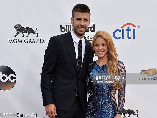 Singer Shakira and soccer player Gerard Pique attend the 2014 Billboard Music Awards at the MGM Grand Garden Arena on May 18, 2014 in Las Vegas,...
