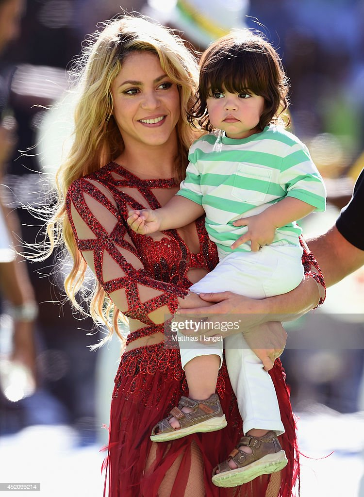 Singer Shakira and son Milan Pique look on during the closing ceremony prior to the 2014 FIFA World Cup Brazil Final match between Germany and Argentina at Maracana on July 13, 2014 in Rio de Janeiro, Brazil.