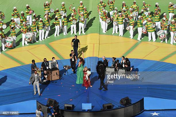 Singer Shakira holds her son Milan Pique as she performs with Alexandre Pires Ivete Sangalo and Carlinhos Brown during the 2014 FIFA World Cup Brazil...