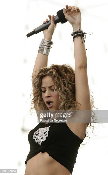 Singer Shakira performs on stage during Live 8 Paris at the Palais de Versailles on July 2 2005 in Paris France The free concert is one of ten...