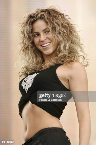 Singer Shakira performs on stage during 'Live 8 Paris' at the Palais de Versailles on July 2 2005 in Paris France The free concert is one of ten...