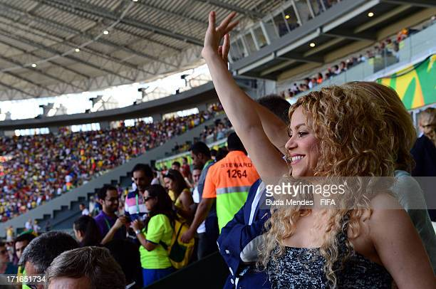 Singer Shakira waves from the stands prior to the FIFA Confederations Cup Brazil 2013 Semi Final match between Spain and Italy at Castelao on June 27...